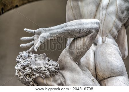 Detail of a desperate old man in Rape of Sabine statue in Florence Italy