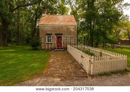 Wall Township NJ USA -- September 12 2017 This red brick building is the 19th century forman's house in historic Allaire Village. Editorial Use Only.