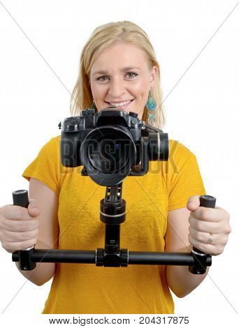 young woman videographer using steady cam isolated on white background
