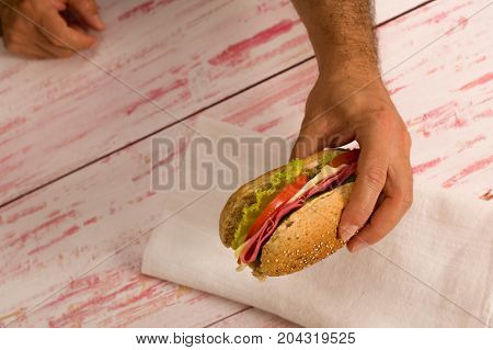man holding a  home made delicious sandwich, close-up