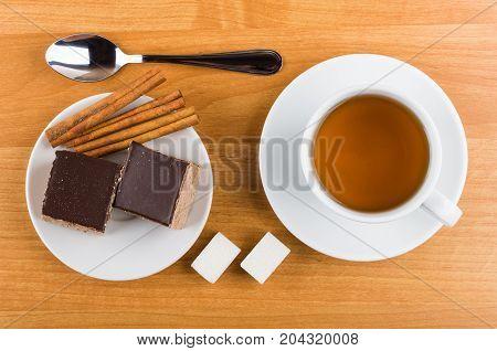 Cakes With Chocolate In Plate, Cinnamon, Sugar, Tea And Teaspoon