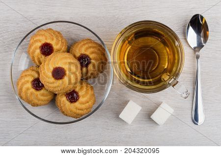Cookies With Jam In Plate, Cup Of Tea, Sugar, Teaspoon