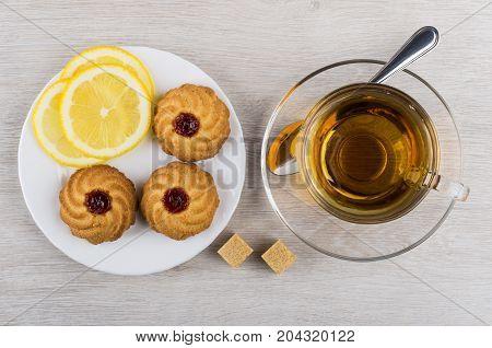 Cup Of Tea, Teaspoon, Saucer With Curabe And Lemon
