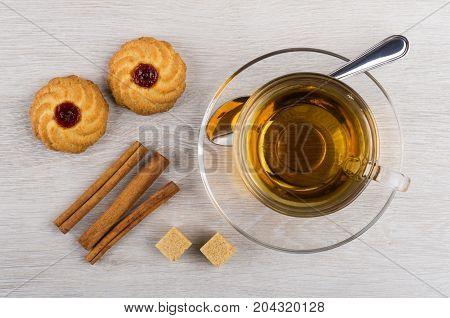 Cup Of Tea, Teaspoon, Curabe, Cinnamon Sticks And Sugar