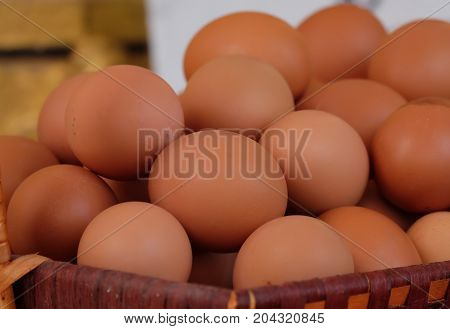 Close up of eggs in a basket. top view of eggs in bowl.