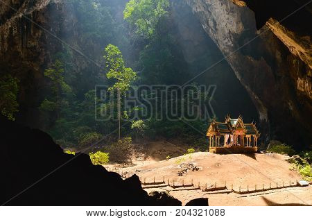Phraya Nakhon Cave. Khao Sam Roi Yot National Park in Thailand. Small temple in the sun rays in cave