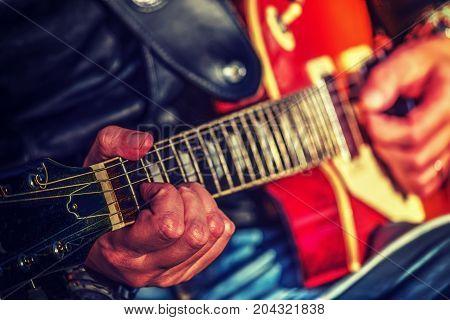 Close up of a guitar player hands