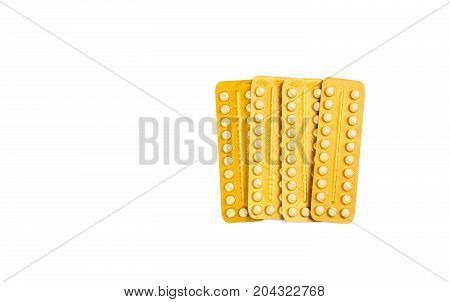 Four blister of contraceptive pills isolated on white background with copy space. Family planning concept.