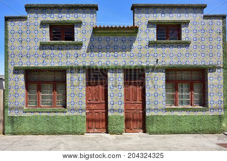 Ancient residential house decorated with traditional portuguese tiles in famous resort Costa Nova on the Atlantic coast in Aveiro district Portugal