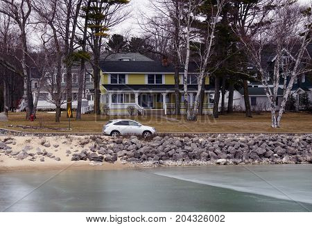 WEQUETONSING, MICHIGAN / UNITED STATES - MARCH 30, 2017: A Lexus RX450h luxury hybrid SUV is parked on Beach Drive in Wequetonsing.
