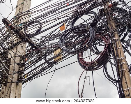 Soft focus image of chaotic line on electric pole on walking street.