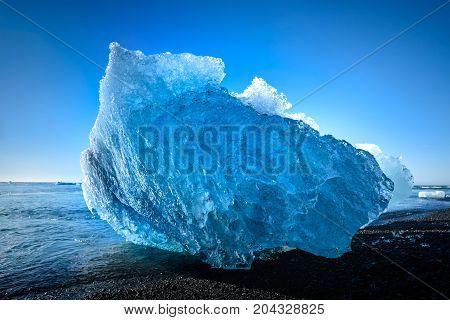 blue iceberg in Jokulsarlon a large glacier lake in south Iceland selective focus