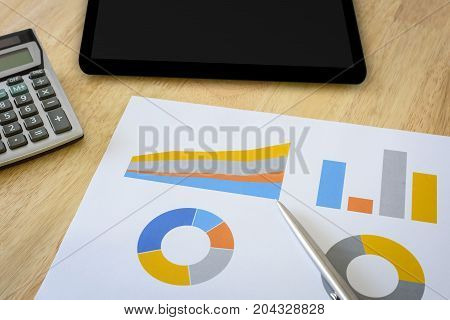 financial chart with calculator and digital tablet