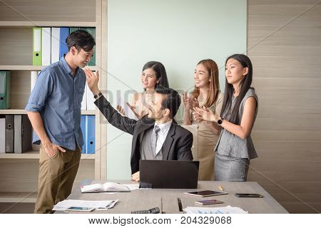 business people clapping in office after signing agreement Achievement congratulation and appreciation concept selective focus