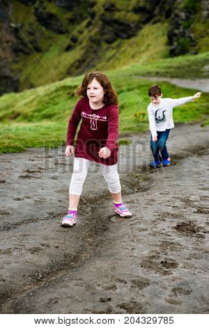 View of Boy and Girl walking up the Cliffs of Moher Tourist Attraction in Ireland