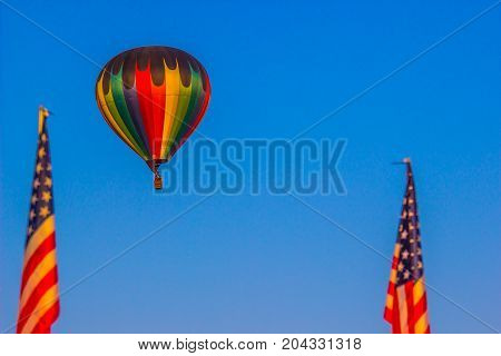 Unique Hot Air Balloon Between Two American Flags