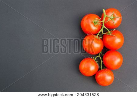 Cherry tomatoes on a black background top view