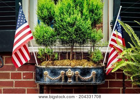 Flags proudly on display in a Virginia window.