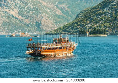 KOTOR, MONTENEGRO - AUGUST 24, 2017: Tourist boat in the sea. Bay of Kotor. Montenegro.