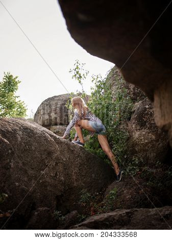 Enjoying the natural view. Climbing the rock. Sport and active life concept.