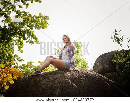 Image of girl at the natural view. Climbing the rock. Sport and active life concept.