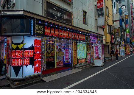 TOKYO, JAPAN JUNE 28 - 2017: Unidentified people waiting near of man-zoku station, located at Kabukicho red lights district, surrounding of big buildings and advertisements, located in Tokyo.