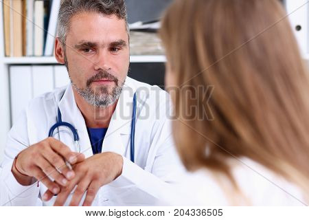 Smiling Handsome Mature Doctor Communicate With Patient