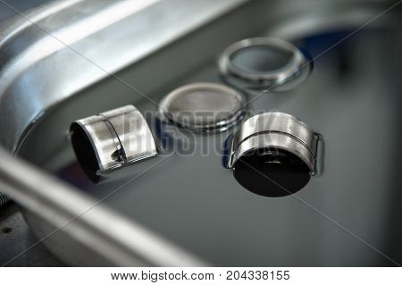 Hydraulic compensators for diesel engine valves are in black oil in oil