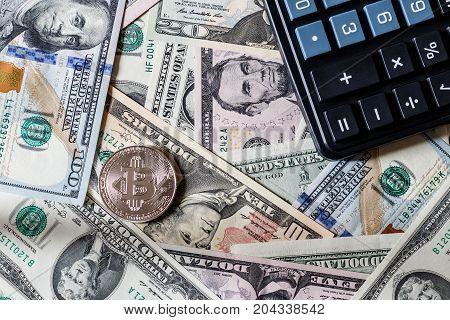 Dollars And Bitcoin And Black Calculator. Cocept.