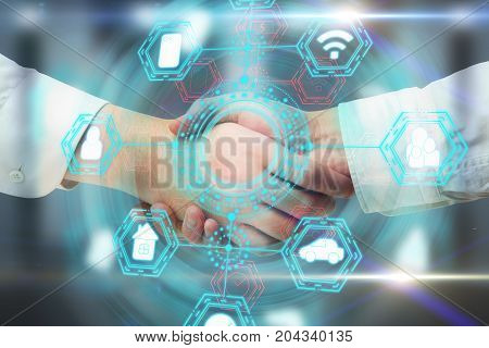 Side view and close up of handshake with abstract digital business network hologram. Teamwork and infograph concept. Double exposure