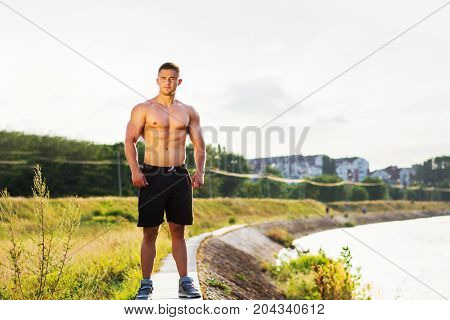 Masculine Man Standing By The River