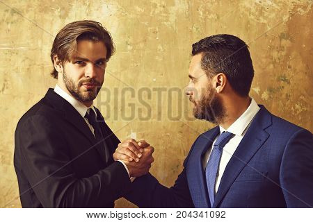 opposition of businessmen or men in suit arm wrestling and power business situation