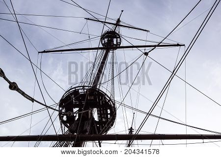 Detail of a sailboat rigging. Mast on traditional sailboats. Mast of large wooden ship