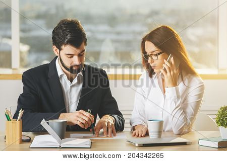 Young Businessman And Woman Using Smartphone