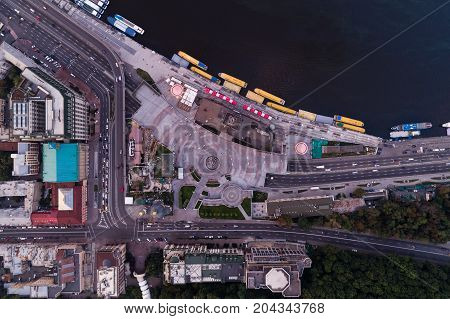 New reconstructed Postal Square in the city of Kiev with a road junction and the main road under it. River Station and the Dnieper River. View from above. Top view. Aerial view