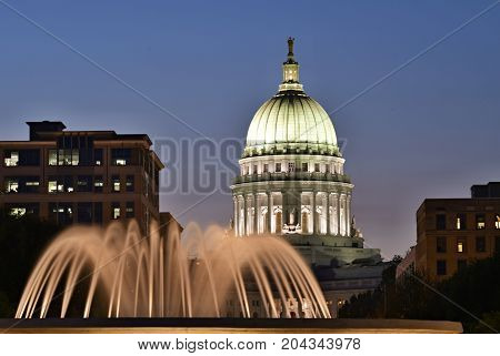 . Madison, Wisconsin, Usa. Night Scene With Capital Building And Illuminated Fountain In The Foregro