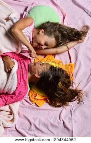 Kids With Happy Faces Lie In Bed