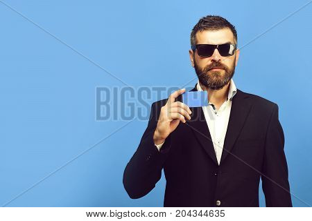 Businessman With Empty Card, Copy Space. Guy With Serious Face