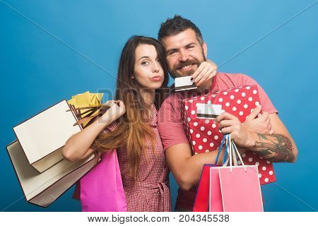 Guy With Beard And Lady Do Shopping. Shopping And Fashion