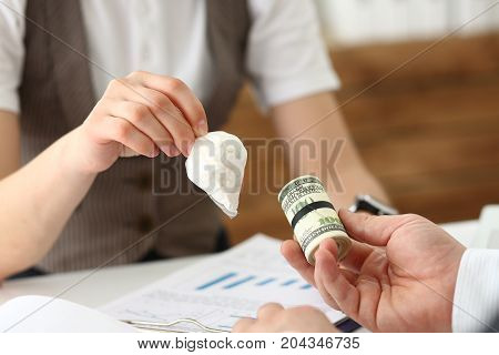 Businessman And Woman Exchanging A Cutlet With Dollars For Narcotic Pills In A Bag, Profit From The