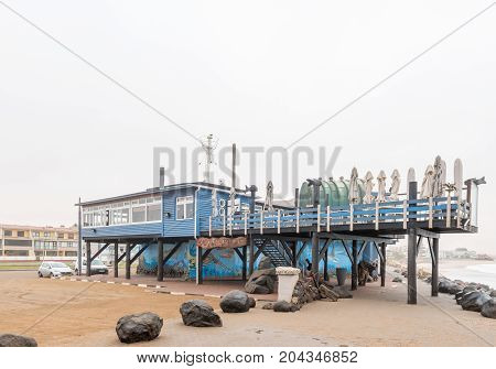 SWAKOPMUND NAMIBIA - JUNE 30 2017: The Tug Restaurant next to the historic jetty in Swakopmund in the Namib Desert on the Atlantic Coast of Namibia