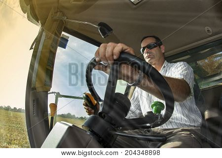 Viewpoint Of The Driver Of The Combine On The Corn Field