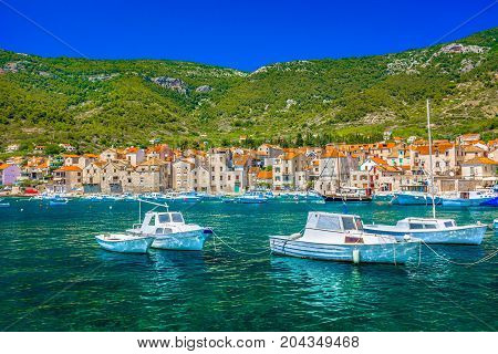 Seafront view at colorful adriatic scenery in town Komiza, famous croatian summer resort on Island Vis.
