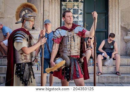 Split Croatia - August 19 2017: Street performers in Diocletian's Palace. Men wear uniforms of the ancient Rome legionary soldiers.