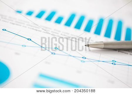 Financial Statistics Documents Ball Pen Infographics At Office Table