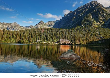 Alpine lake Popradske pleso with touristic shelter - Chata pri popradskom plese, in the morning with a great view on Tatra mountains.