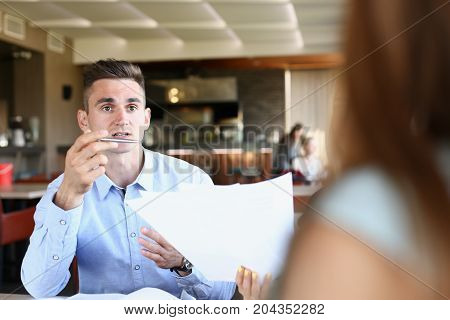 Businessman Explains The Policy Of The Enterprise Discuss