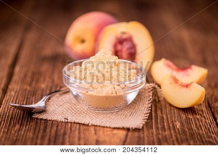 Wooden Table With Ground Peaches, Selective Focus