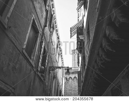 Venice scenic historic old streets architecture. Italian Lagoon. Building with traditional architecture on a narrow street in Venice, Italy.