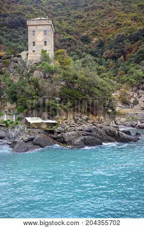SAN FRUTTUOSO DI CAMOGLI (GE), ITALY - SEPTEMBER 10, 2017: The world famous Doria Tower of San Fruttuoso, little bay along the shores of the Ligurian Sea (Northern Italy), UNESCO World Heritage site. Photo taken in a public place.